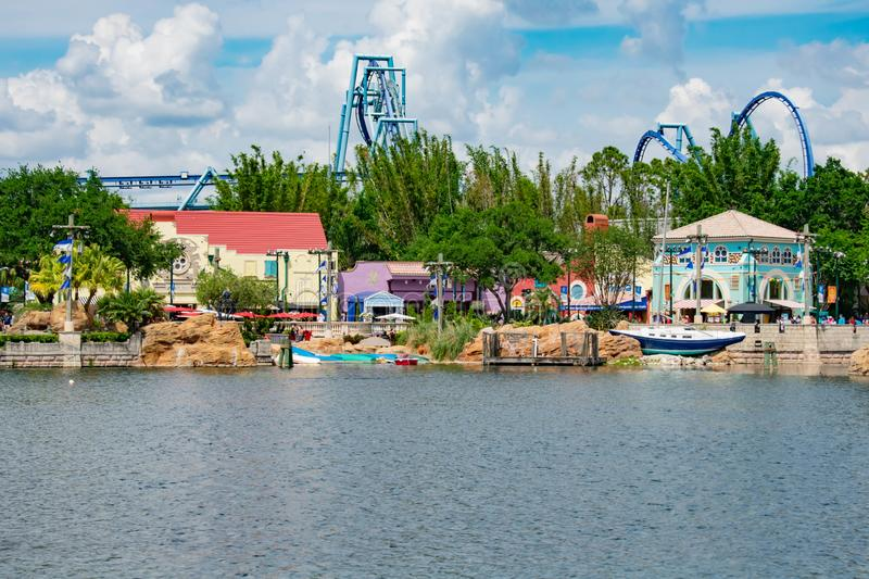 View of  Colorful restaurant , store and partial view of Manta Ray rollercoaster at Seaworld in International Drive area  2 royalty free stock photos