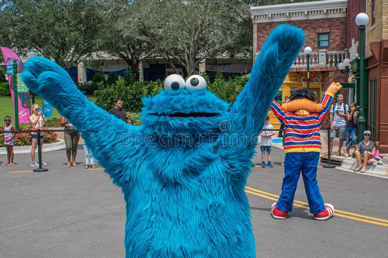 Cookie Monster dancing in Sesame Street Party Parade at Seaworld 6. Orlando, Florida. August 28, 2019. Cookie Monster dancing in Sesame Street Party Parade at stock photos