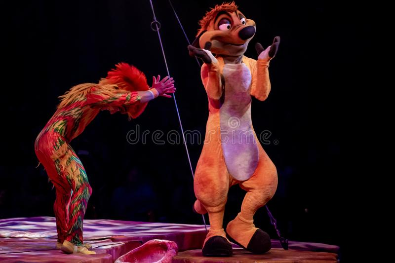Monkey acrobat and Timon in Lion King Festival at Animal Kingdom 49. Orlando, Florida. August 14, 2019. Monkey acrobat and Timon in Lion King Festival at Animal royalty free stock images