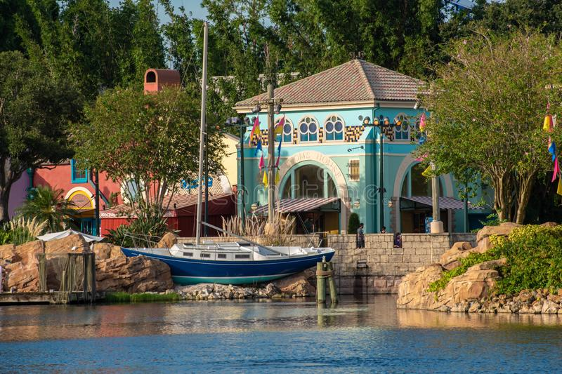 Partial view of colorful african style buildings and sail boat at Seaworld . 2 stock images
