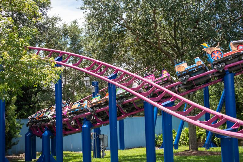 People enjoying Super Grovers Box Car Derby. It is a family friendly rollercoaster in Sesame Street at Seaworld 14. Orlando, Florida. August 07, 2019. People stock photos