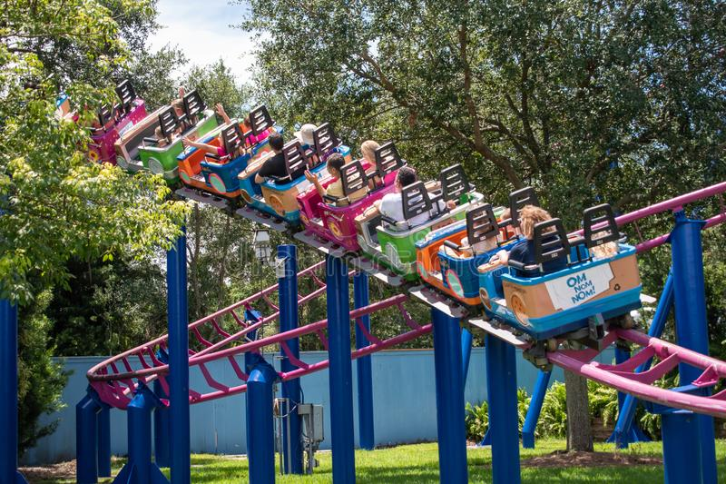 People enjoying Super Grovers Box Car Derby. It is a family friendly rollercoaster in Sesame Street at Seaworld 18. Orlando, Florida. August 07, 2019. People royalty free stock image