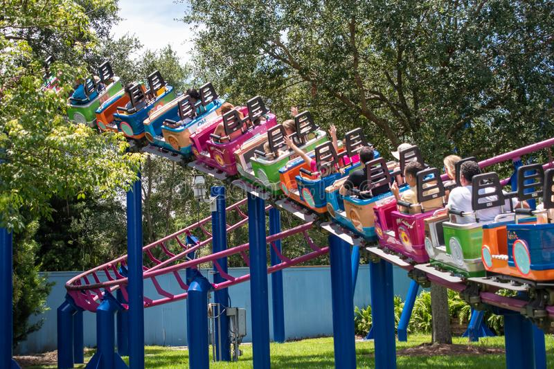 People enjoying Super Grovers Box Car Derby. It is a family friendly rollercoaster in Sesame Street at Seaworld 17. Orlando, Florida. August 07, 2019. People stock image