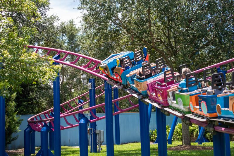 People enjoying Super GroverS Box Car Derby. It is a family friendly rollercoaster in Sesame Street at Seaworld 15. Orlando, Florida. August 07, 2019. People royalty free stock image