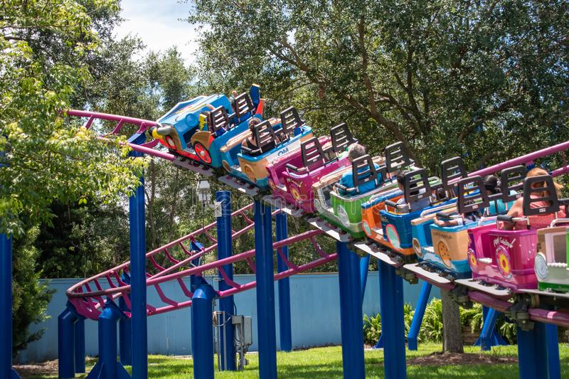 People enjoying Super Grovers Box Car Derby. It is a family friendly rollercoaster in Sesame Street at Seaworld 16. Orlando, Florida. August 07, 2019. People royalty free stock photos