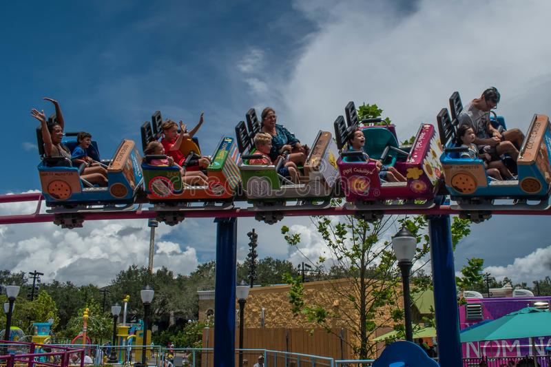 People enjoying Super Grovers Box Car Derby. It is a family friendly rollercoaster in Sesame Street at Seaworld 9. Orlando, Florida. August 07, 2019. People royalty free stock photo