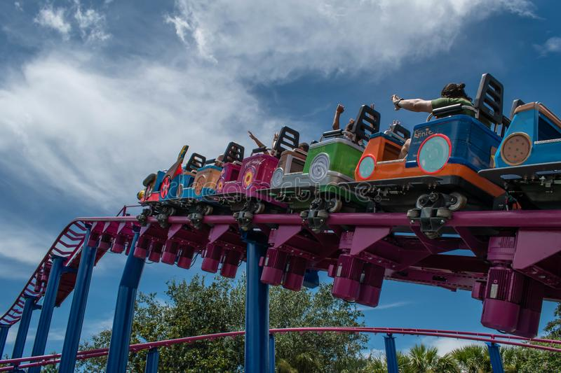 People enjoying Super Grovers Box Car Derby. It is a family friendly rollercoaster in Sesame Street at Seaworld 3. Orlando, Florida. August 07, 2019. People stock photography