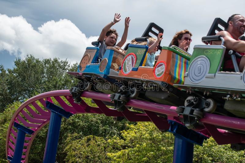 People enjoying Super Grovers Box Car Derby. It is a family friendly rollercoaster in Sesame Street at Seaworld 24. Orlando, Florida. August 07, 2019. People royalty free stock photos
