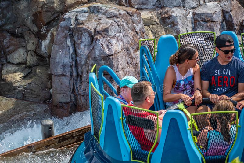 People having fun Infinity Falls, during last summer at Seaworld , 49. Orlando, Florida. August 28, 2019. People having fun Infinity Falls, during last summer at royalty free stock photos