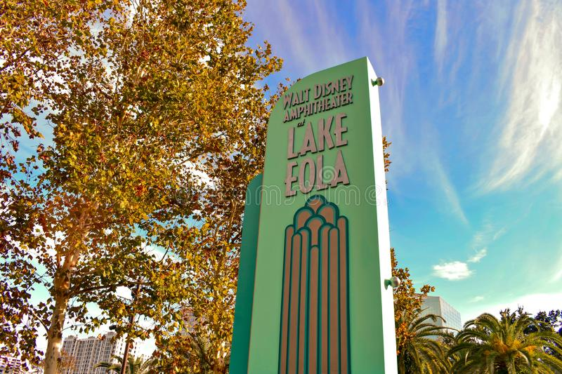 Amphitheater sign, autumn trees and palm trees at Lake Eola Park in Orlando Downtown area. stock photography