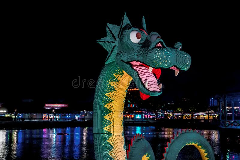Orlando, Florida, December 2017: Night view of Colorful Lego Loch Ness Dragon Monster at Lake Buena Vista. Orlando, Florida - December 2017: Night view of Lego royalty free stock photos