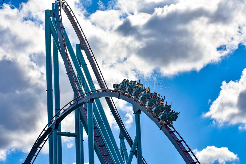 People enjoy thrills for ride of the Mako roller coaster in amusement park at Seaworld in International Drive area 1 stock images