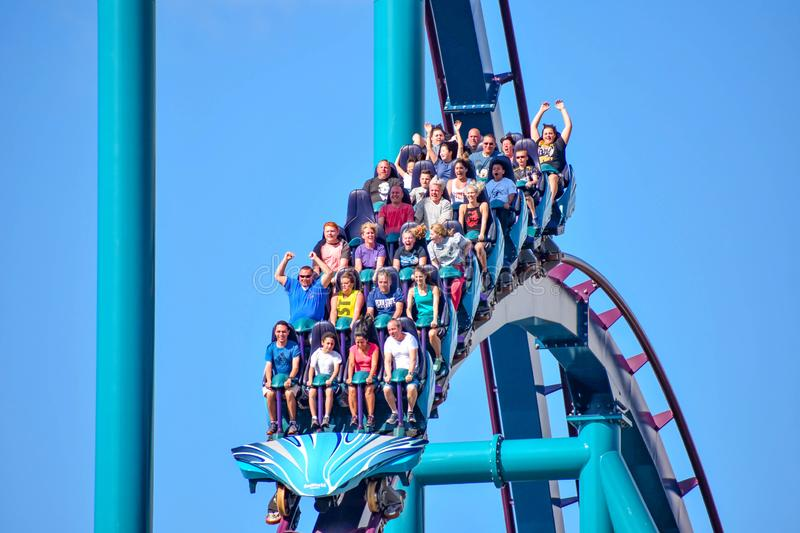 People enjoy thrills for ride of the Mako roller coaster in amusement park at Seaworld in International Drive area 5. Orlando, Florida. December 26, 2018. People stock images