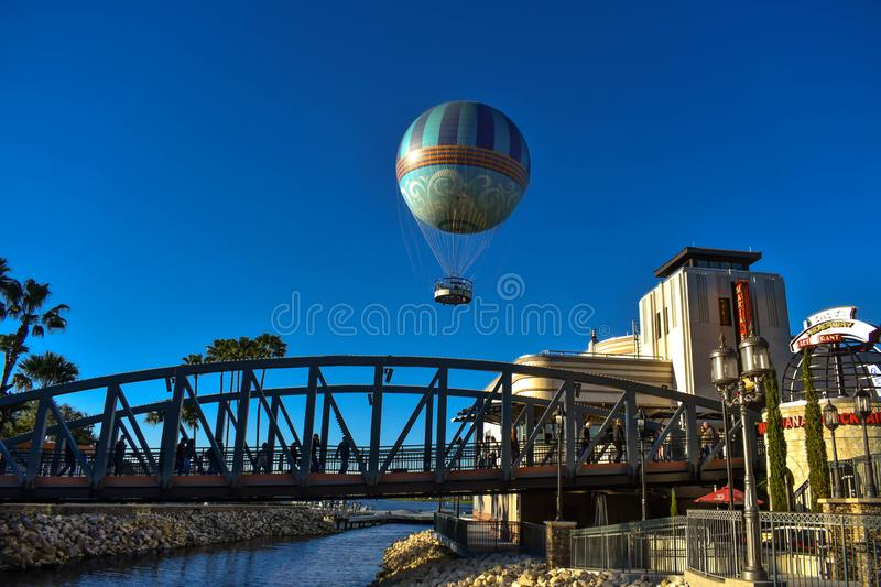 Palms, Bridge, colorful air balloon and Art Deco style architecture on light blue sky background at Lake Buena Vista area. royalty free stock images