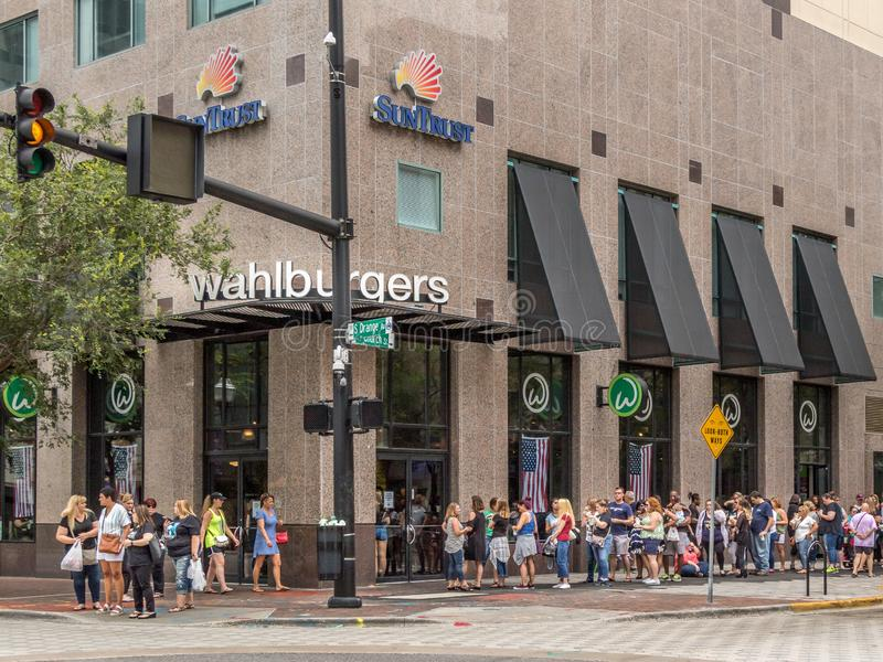 ORLANDO, FLORIDA - JULY 13, 2019: WAHLBURGERS.  A long line of people forms outside a new burger joint in downtown Orlando stock photography