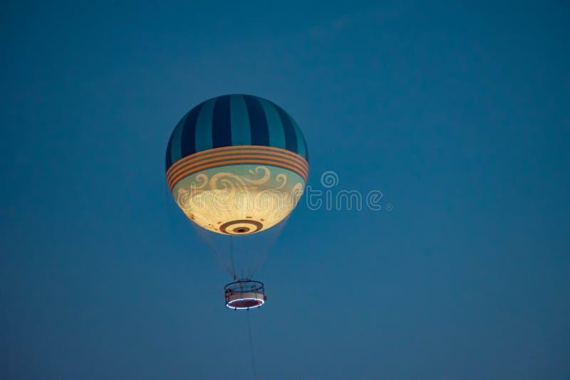 Air balloon flying on blue night at Lake Buena Vista . Orlando, Florida. June 15, 2019. Air balloon flying on blue night at Lake Buena Vista royalty free stock photo