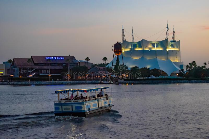 Cirque du Soleil , House of Blues and taxi boat sailing in Disney Springs at Lake Buena Vista . royalty free stock images