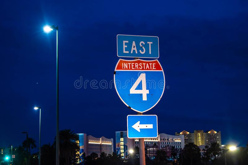 East Interstate 4 sign on blue night background  at Universal Studios area. Orlando, Florida. June 13, 2019. East Interstate 4 sign on blue night background  at stock photo