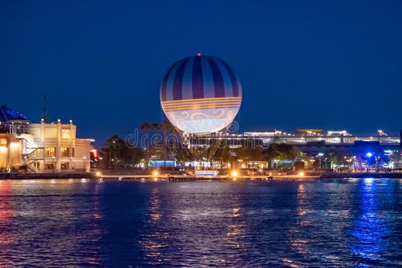 Panoramic view of dockside and air balloon on blue night at Lake Buena Vista. Orlando, Florida. June 15, 2019.  Panoramic view of dockside and air balloon on stock photos
