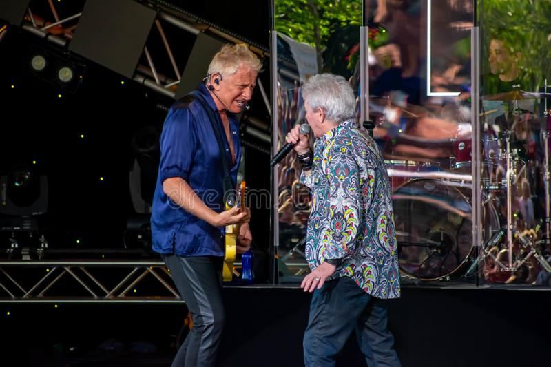 Singing beautiful melody at Epcot in Walt Disney World  4. Orlando, Florida. March 26, 2019. Graham Rusell and Russell Hitchcock  from air supply, singing stock photo