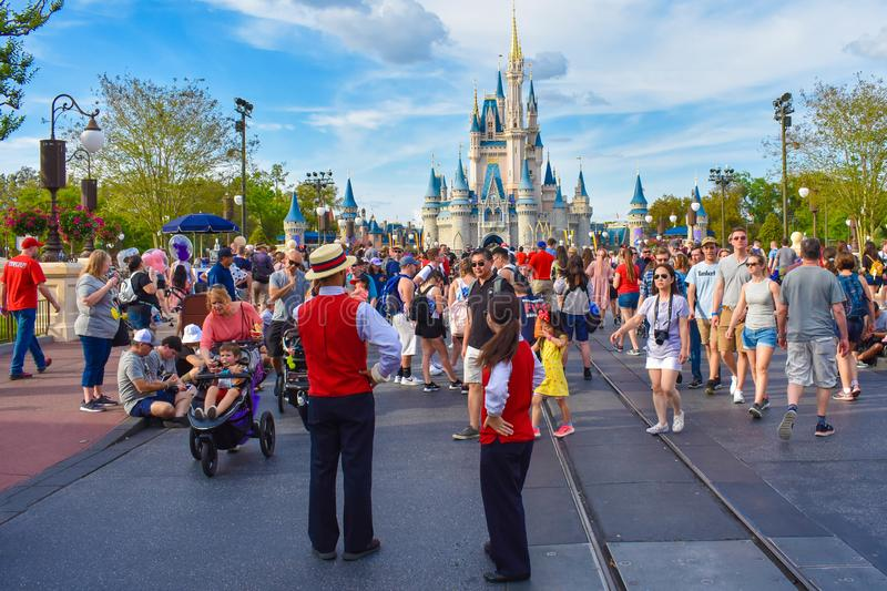 Panoramic view of Cinderella`s Castle  and people walking on main street in Magic Kingdom at Walt Disney World . Orlando, Florida. March 19, 2019. Panoramic royalty free stock photos