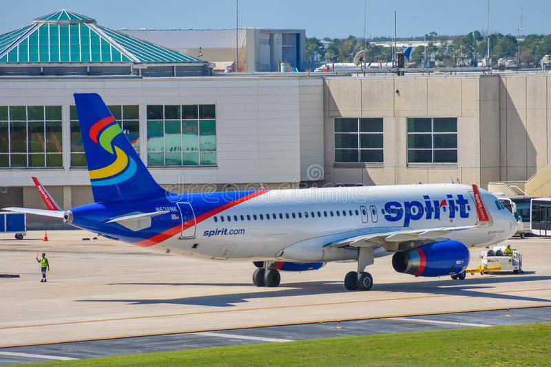 View of airplane from Spirit Airlines NK  at the gate in Orlando International Airport MCO  2. Orlando, Florida.  March 03, 2019. View of airplane from Spirit royalty free stock photo