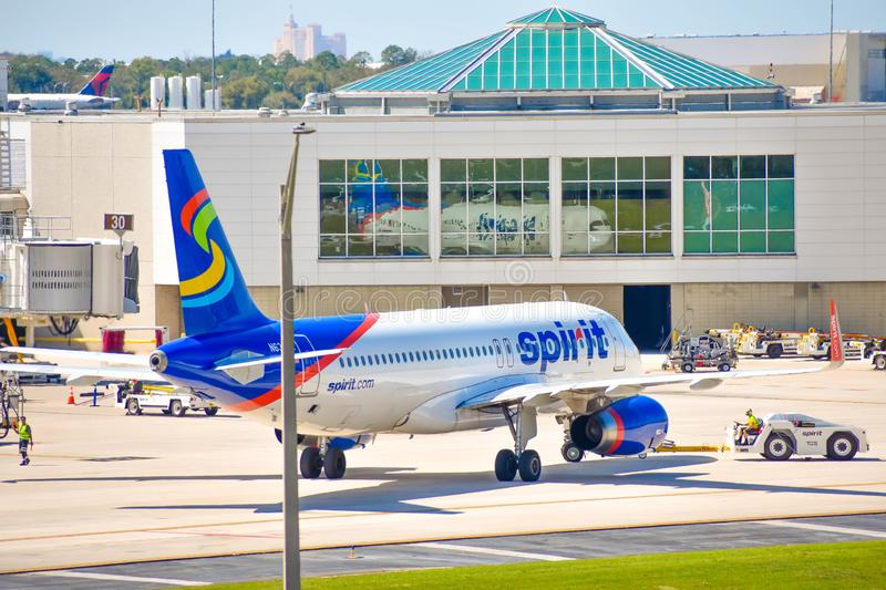 View of airplane from Spirit Airlines NK  at the gate in Orlando International Airport MCO   3. Orlando, Florida.  March 02, 2019. View of airplane from Spirit royalty free stock photography