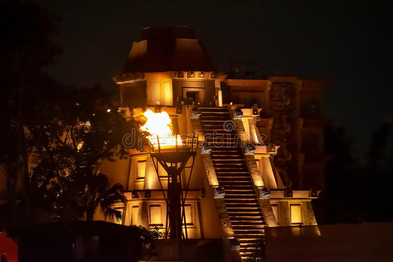Mexican Pyramid and giant fire torch at Epcot. stock photo