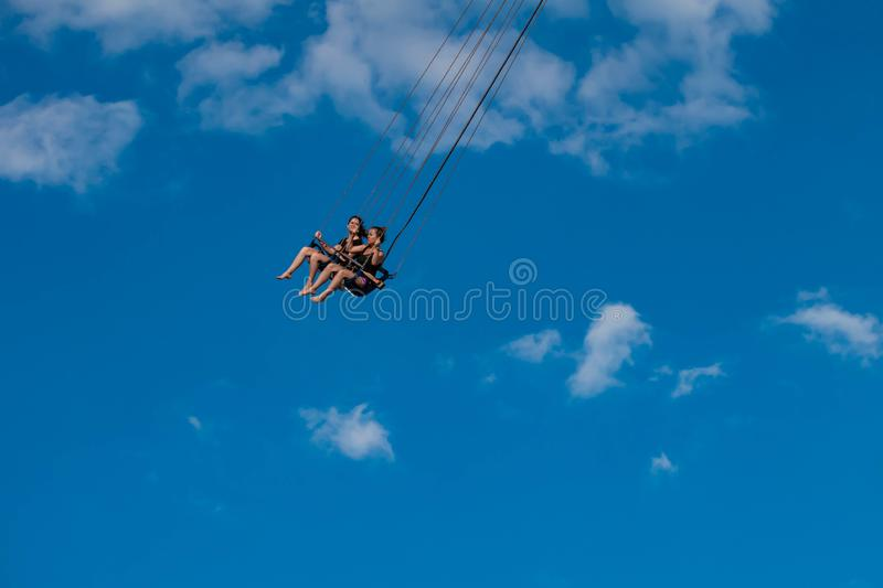 """People enjoying Orlando Star Flyer. It is the """"world's tallest swing ride standing at 450 feet.  in International Drive area. Orlando, Florida. May royalty free stock photos"""