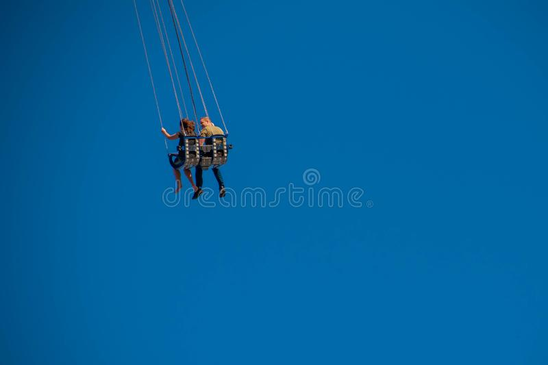 """People enjoying Orlando Star Flyer. It is the """"world's tallest swing ride standing at 450 feet.  in International Drive area. Orlando, Florida. May stock image"""