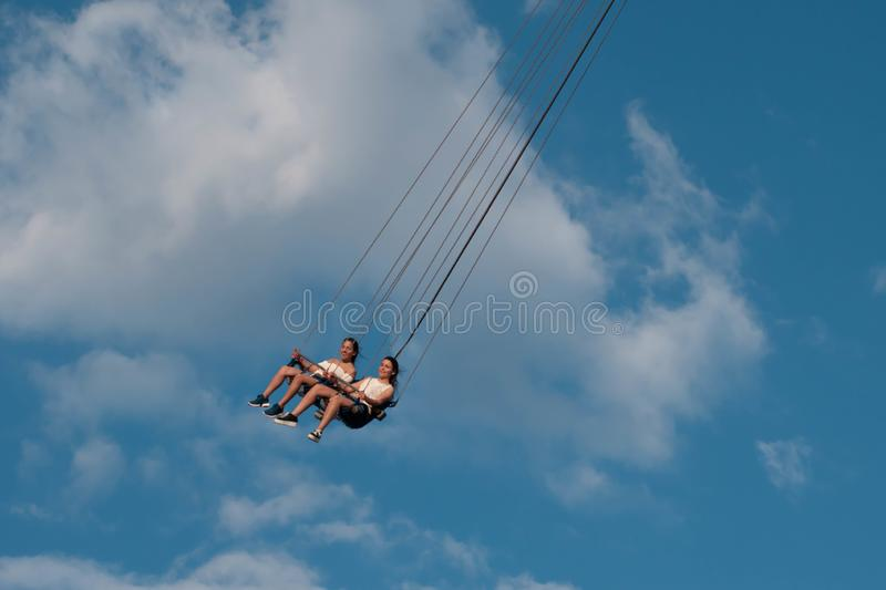 """People enjoying Orlando Star Flyer. It is the """"world's tallest swing ride standing at 450 feet.  in International Drive area. Orlando, Florida. May royalty free stock images"""