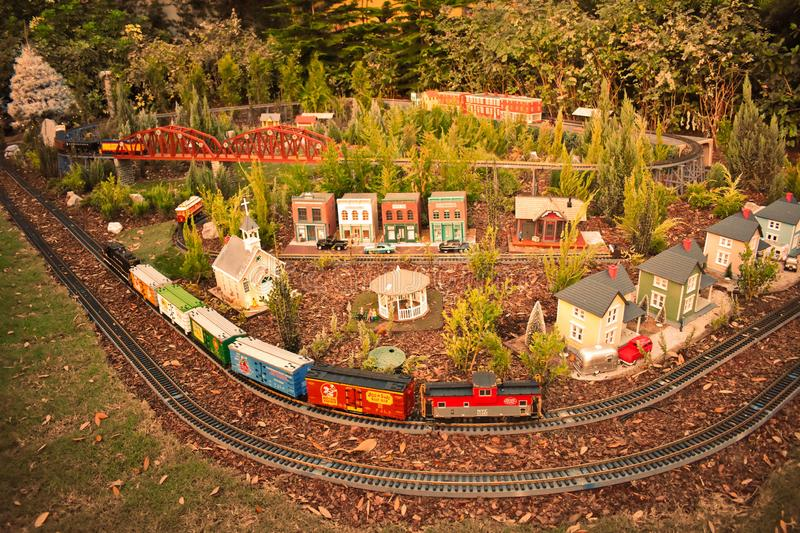 Colorful Miniature train, bridge and Christmas Tree on forest background in International Drive area stock image