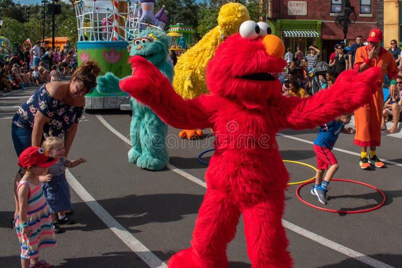 Elmo, Zoe and Big Bird dancing with childs and parents in Sesame Street Party Parade at Seaworld 6. Orlando, Florida. November 06, 2019. Elmo, Zoe and Big Bird stock photos