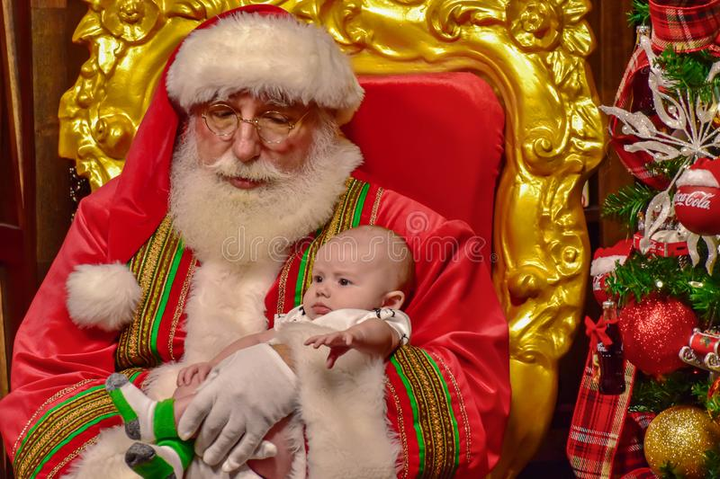 Santa Claus with nice baby on Christmas Celebration at Seaworld royalty free stock images
