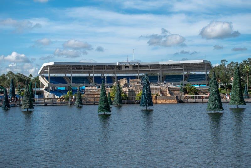 Christmas trees and panoramic view of Bayside Stadium on blue lake at Seaworld stock photos