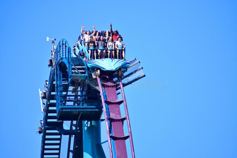 A group of people enjoy a fast Mako roller coaster ride at Seaworld Theme Park in Internatio stock photos