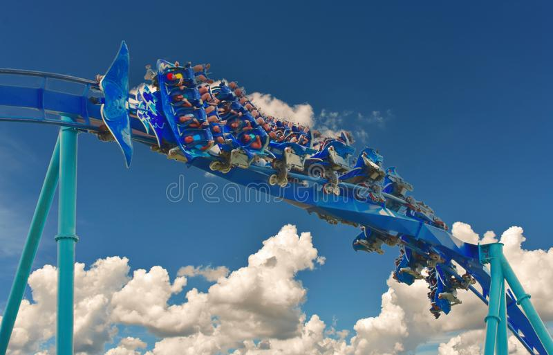 Group of people enjoy a fast Manta Roller coaster at Seaworld Orlando. royalty free stock image