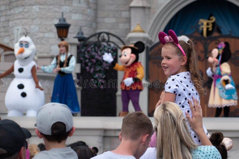 Nice little girl enjoying Mickeys Royal Friendship Faire on Cinderella Castle in Magic Kingdom at Walt Disney World Resort 1 stock images