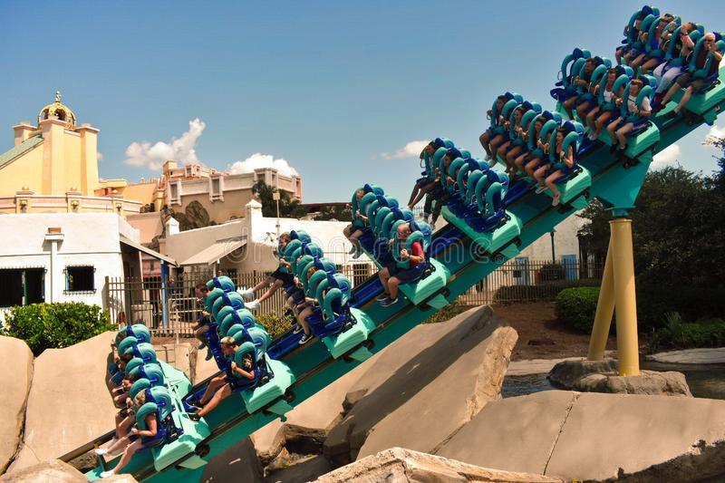 Young people entering a tunnel in Kraken Rollercoaster at Seaworld. royalty free stock image