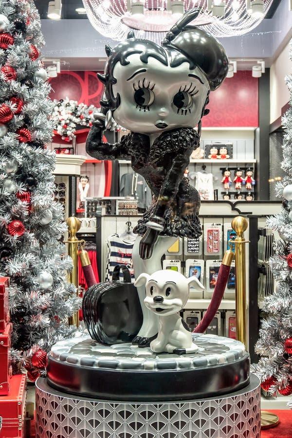 ORLANDO, FLORIDA, USA - DECEMBER, 2017: Betty Boop Cartoon Character in a shop Window Display Christmas decorated at Universal Stu. ORLANDO, FLORIDA, USA royalty free stock images