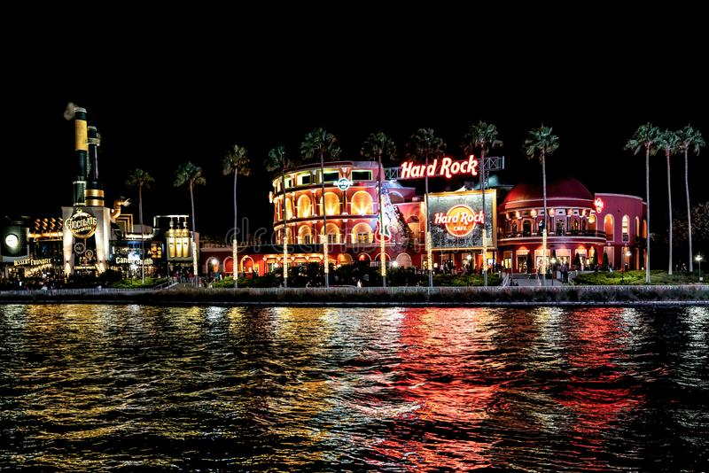 ORLANDO, FLORIDA, USA - DECEMBER, 2017: Highlights of Hard Rock Cafe at Universal Studios entrance to the theme park at night. ORLANDO, FLORIDA, USA - DECEMBER stock image