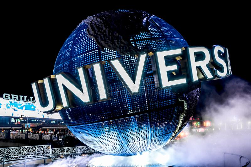 ORLANDO, FLORIDA, USA - DECEMBER, 2017: Highlights of the Iconic Universal Studios globe located at the entrance to the theme park. At night stock image