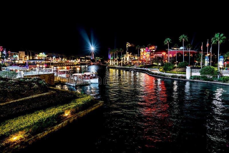 ORLANDO, FLORIDA, USA - DECEMBER, 2017: Highlights of Universal Studios entrance to the theme park at night. ORLANDO, FLORIDA, USA - DECEMBER, 2017: Highlights royalty free stock photos