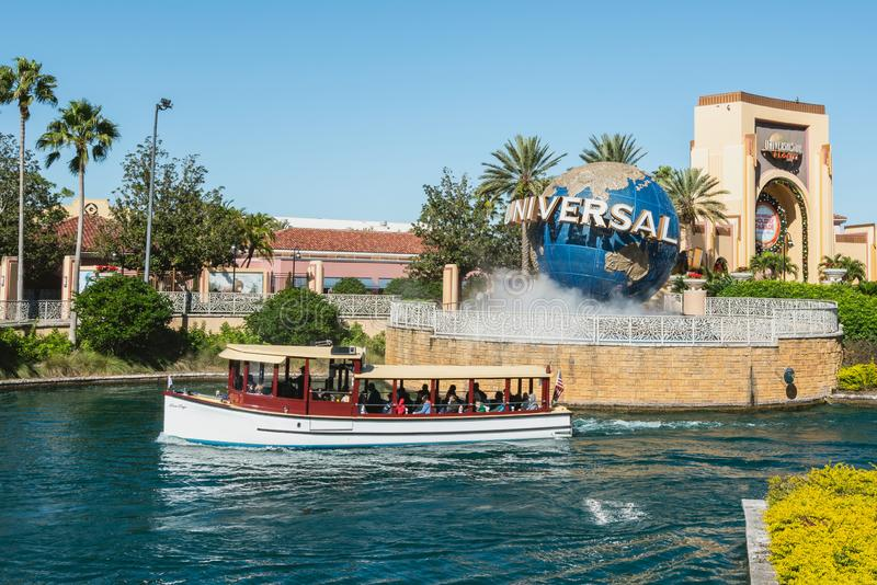 ORLANDO, FLORIDA, USA - DECEMBER, 2017: Iconic Universal Studios globe located at the entrance to the theme park. ORLANDO, FLORIDA, USA - DECEMBER, 2017: Iconic stock photography