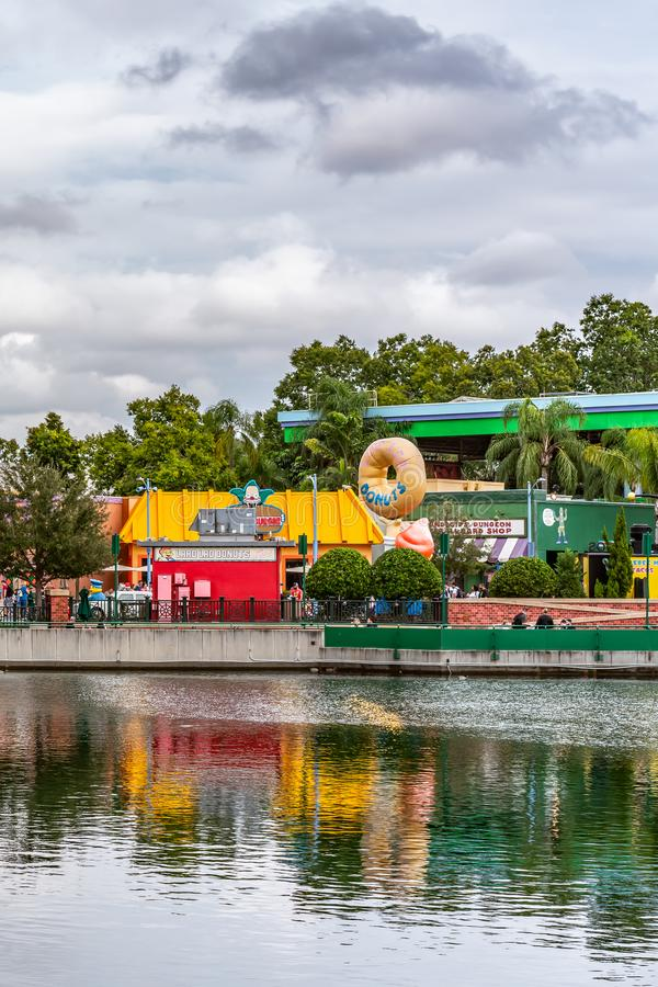 ORLANDO, FLORIDA, USA - DECEMBER, 2018: Lake with Simpsons Area at the background, Universal Studios royalty free stock image