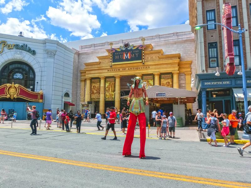 ORLANDO, FLORIDA, USA - MAY 08, 2018: Entrance to Revenge of the Mummy ride at Universal Studios Orlando. ORLANDO, FLORIDA, USA - MAY 08, 2018: The man on stilts stock photos