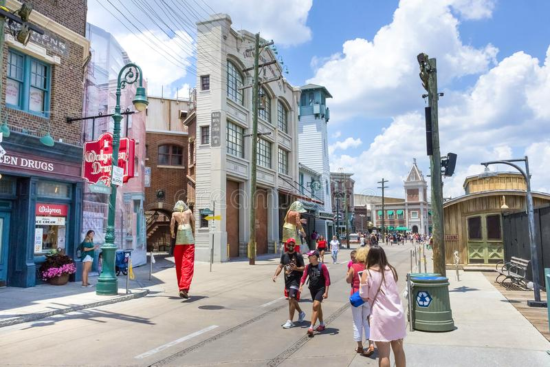 ORLANDO, FLORIDA, USA - MAY 08, 2018: Entrance to Revenge of the Mummy ride at Universal Studios Orlando. ORLANDO, FLORIDA, USA - MAY 08, 2018: The man on stilts royalty free stock photography