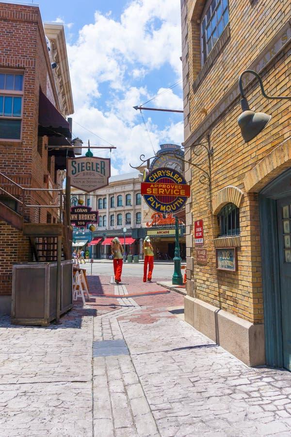 ORLANDO, FLORIDA, USA - MAY 08, 2018: Entrance to Revenge of the Mummy ride at Universal Studios Orlando. ORLANDO, FLORIDA, USA - MAY 08, 2018: The man on stilts stock photography