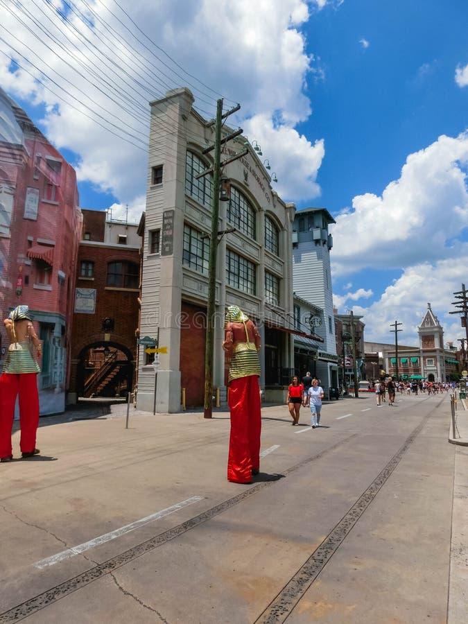 ORLANDO, FLORIDA, USA - MAY 08, 2018: Entrance to Revenge of the Mummy ride at Universal Studios Orlando. ORLANDO, FLORIDA, USA - MAY 08, 2018: The man on stilts royalty free stock image