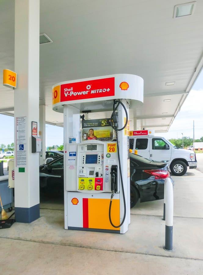 Orlando, USA - May 8, 2018: Filling nozzles at a Shell gas station. Orlando, USA - May 8, 2018: Filling nozzles at a Shell gas station at Orlando, USA on May 8 royalty free stock photos
